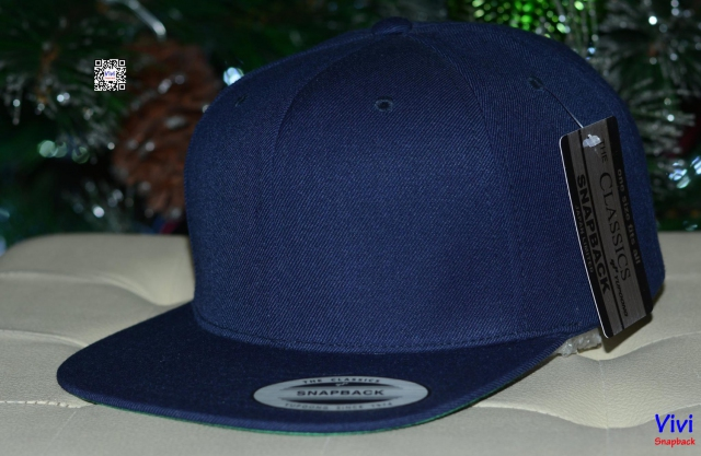 The Classic Yupoong Navy Snapback